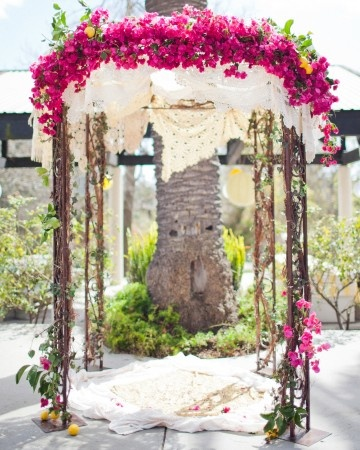 Chuppah made from vintage linens, flowers and lemons