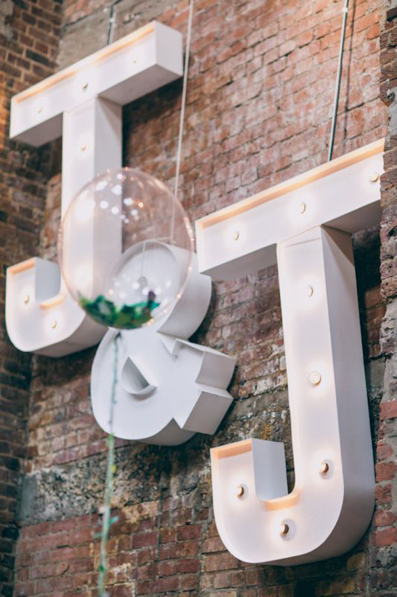 Giant initials lighting sign