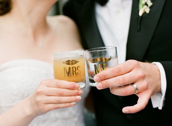 his and hers glasses with respective signature cocktails