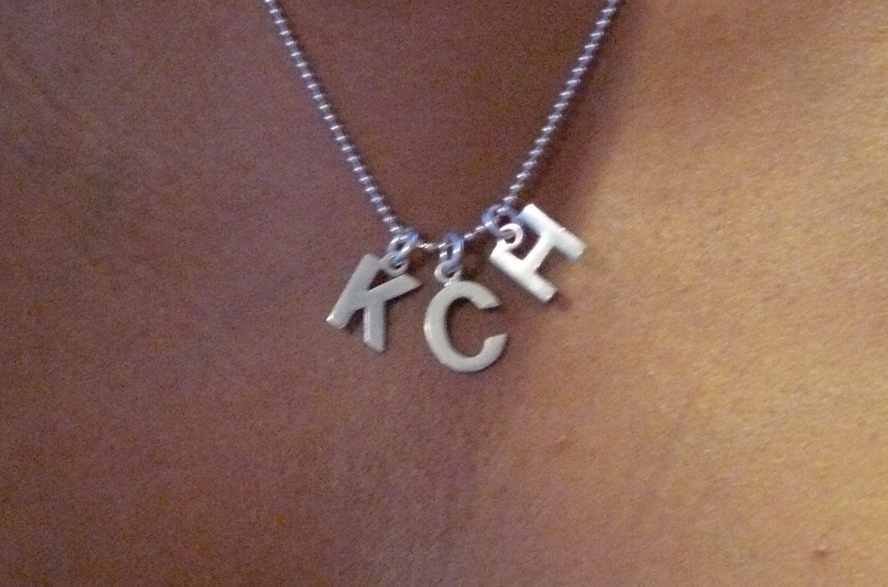 Wedding necklace - Surprise him after the ceremony by wearing a necklace with your new initials for the reception