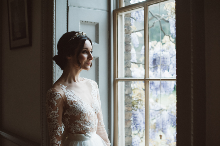 sultry eye makeup chignon bun hair with cathedral veil and flowers fulham palace south west london hair and makeup artist