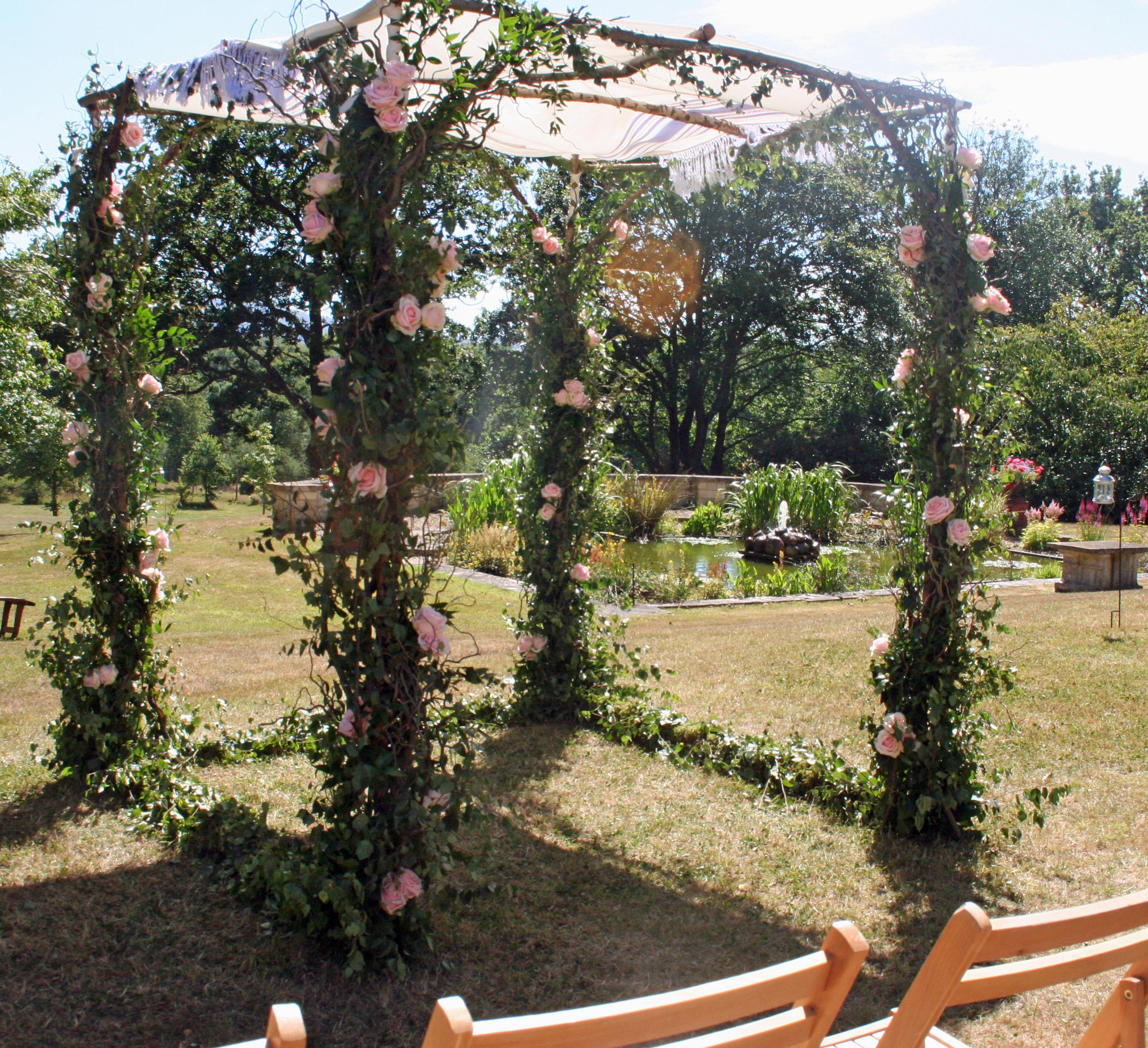Rose-strewn chuppah by Mary Jane Vaughan flowers
