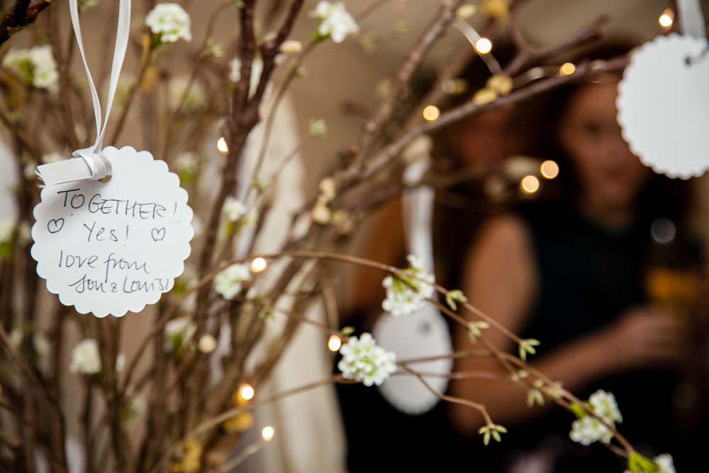 Guests write wish cards for the Bride and Groom instead of a formal Guestbook  as seen in Emma & Simon's Enchanting Garden Wedding