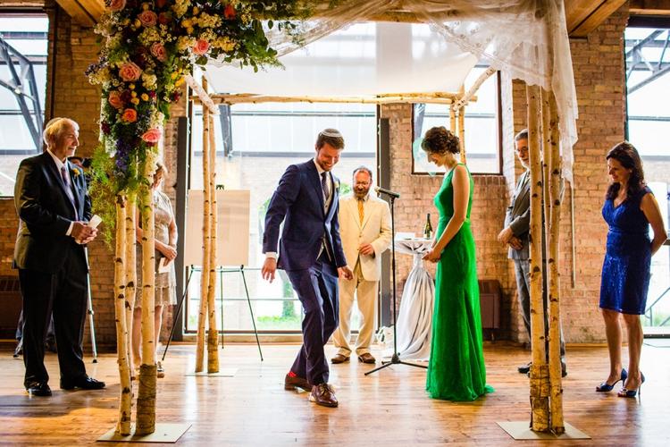 A bride in a green wedding dress for a creative Jewish wedding at Bridgeport Art Center, Chicago, USA