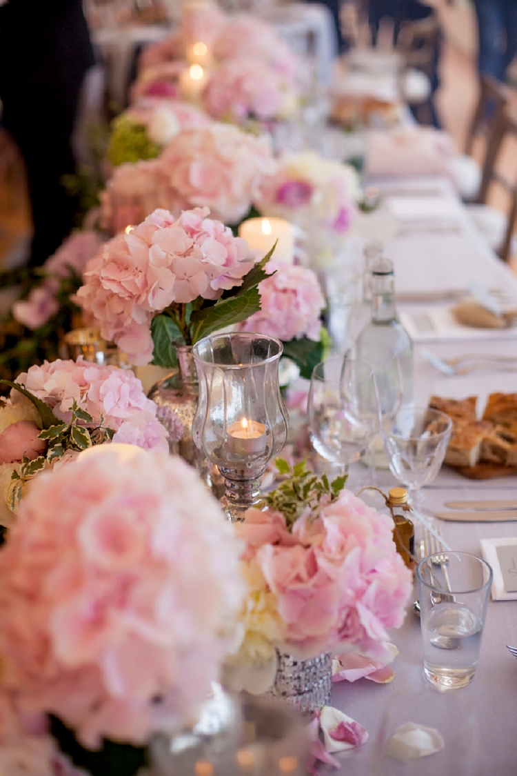A rustic Jewish wedding with an abundance of flowers and a Sophia ...
