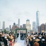 A glamorous Big Apple Jewish wedding with a chuppah overlooking the NYC skyline at Tribeca Rooftop, New York, USA