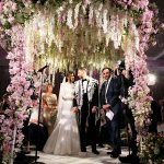 A Suzanne Neville Bride for a Flower-Forward Jewish Wedding with the Ultimate Floral Chuppah at The Grove, Chandlers Cross, UK