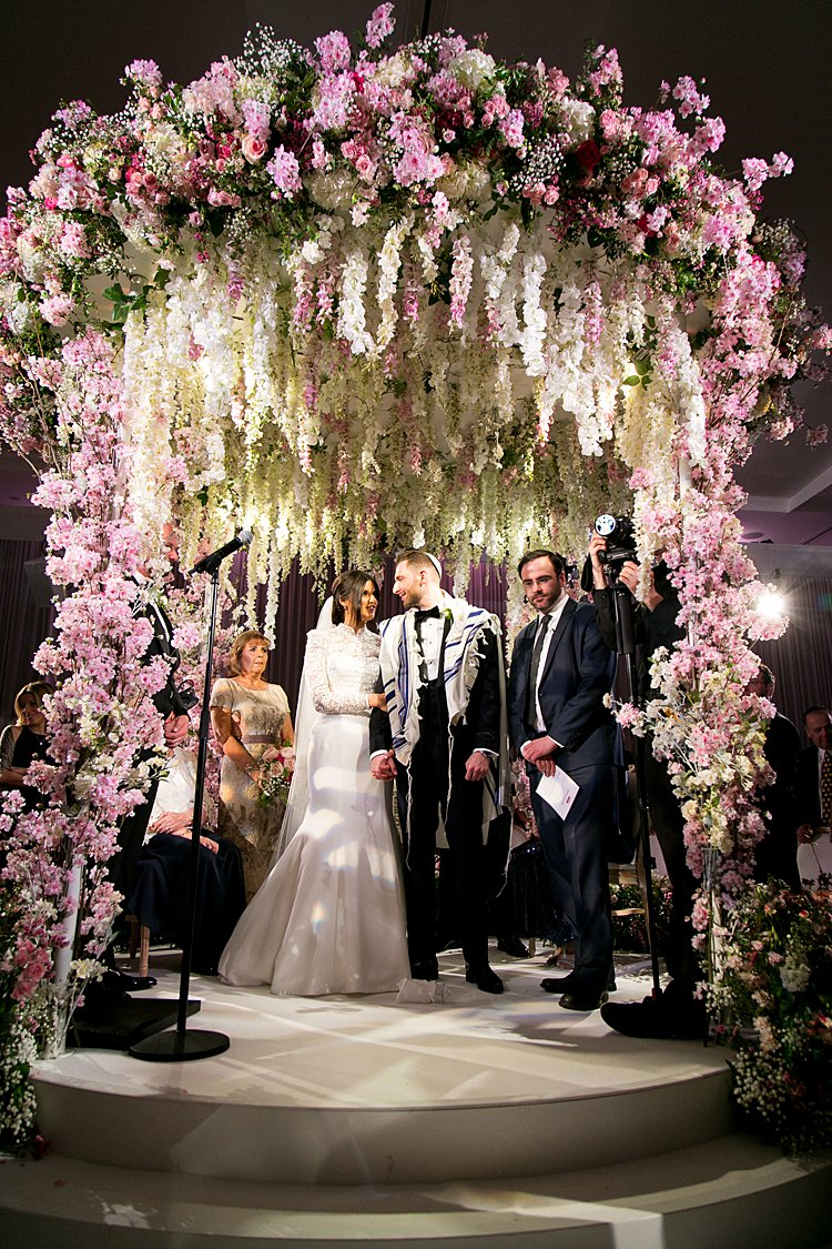 717152a0e5f A Suzanne Neville Bride for a Flower-Forward Jewish Wedding with the  Ultimate Floral Chuppah at The Grove