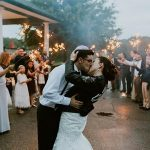 A Rebecca Ingram Bride in a Leather Jacket for a Trilingual Rustic Jewish Wedding at Ferncroft Country Club in Middleton, Massachusetts, USA