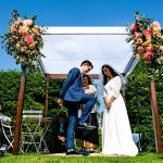A Charlie Brear Bride for a Fashionably Floral Outdoor Jew-ish Wedding at the Bride's Parents' Holiday Home in Old Minster Lovell, Cotswolds, UK