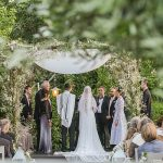 A Rosa Clara Bride for a Secret Garden Destination Jewish Wedding with a Willow Chuppah at The Q in Herzliya, Israel